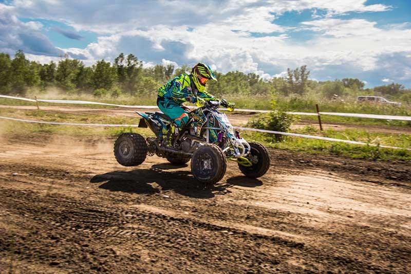 Person riding 99cc ATV